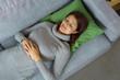 canvas print picture - frau liegt schlafend auf der couch
