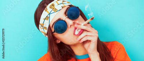 Fototapeta Hippy girl portrait smoking weed and wearing sunglasses letterbox obraz