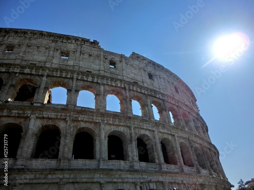 Fotografie, Obraz  Roman coliseum exterior with shining sun