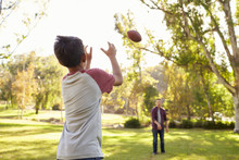 Dad And Son Throwing American ...