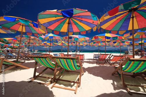 Beach chairs and parasol on Koh Khai island. Phuket, Thailand. Canvas Print