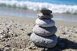 Balance Zen Stones on Sand Sea