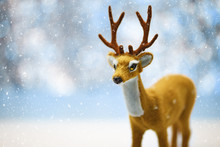 A Cute Young Reindeer In A Defocused Winter Landscape Background