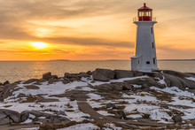 Peggy's Cove Lighthouse With A Winter Sunset
