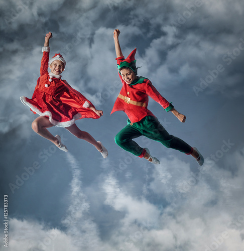 Funny kids in Peter pan and snow maiden costume. Canvas Print