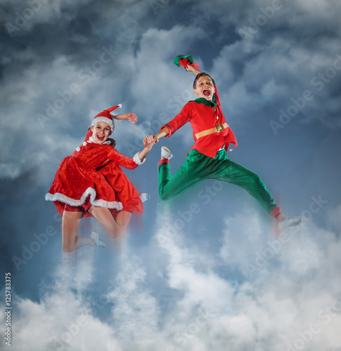 Funny kids in Peter pan and snow maiden costume. Wallpaper Mural