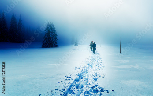 People alone in Winter blizard. Beautiful mountain snowy landscape.