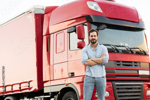 Obraz masculine truck driver in jeans with his truck behind - fototapety do salonu