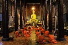 Buddhist Monks Pray And Medita...