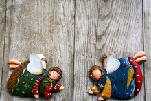 Christmas Ceramic  Angels On Wooden Background
