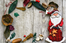 Frame Of Pot Pourry And Wooden Santa Klaus On Wooden Background