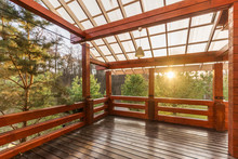 Large Porch Of The Log Cabin At Sunset With Forest View