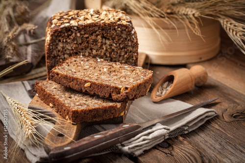 Fotografie, Obraz  Whole Grain rye bread with seeds.