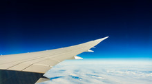 Aircraft Wing In Flight With Wingflex And Dark Blue Sky (Boeing 787)