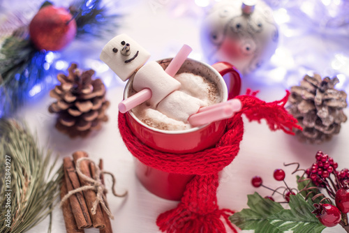 Spoed Foto op Canvas Chocolade Christmas drink. Hot chocolate with marshmallow snowman in red cup