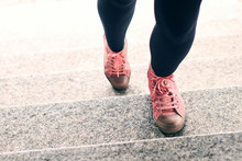 Woman Legs In Black Leggings And Pink Sneakers Climbing Stairs Outdoor