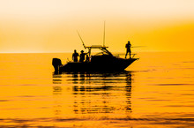 Silhouette Of Sport Fishing Boat Reflecting On Calm Water
