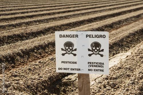 Cuadros en Lienzo Danger Pesticide Sign In Field