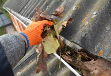 Rain Gutter Cleaning From Leav...