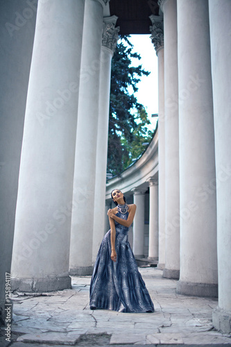 young lady in dress at the entrance of neoclassical building Wallpaper Mural