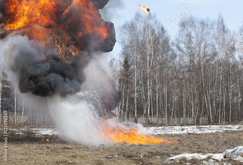 Valokuva  Explosion in action with fire ball and smoke
