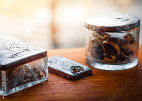 Vintage silver jewelry boxes and a ring, on wooden background  Old
