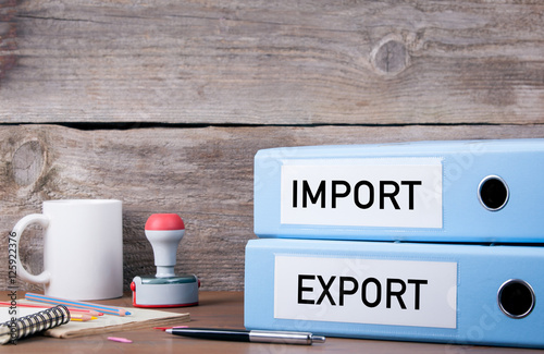 Fotografia, Obraz  Import and Export. Two binders on desk in the office. Business b