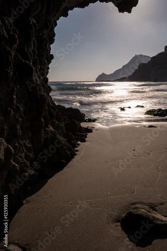 Papiers peints Cappuccino Landscape from a small cave. Media Luna beach. San Jose. Natural Park of Cabo de Gata. Spain.