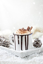 Homemade Christmas Hot Chocolate With Whipped Cream, Cacao And Cinnamon On A Plate On Christmas Holiday Background