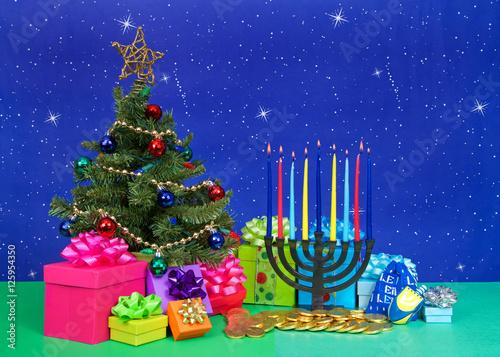 christmas tree with presents next to hanukkah menorah burning candles dreidel chocolate gold coin