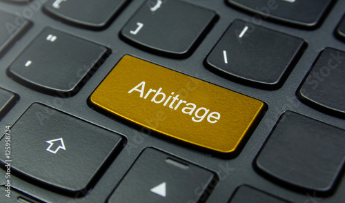 Business Concept: Close-up the Arbitrage button on the keyboard and have Gold, Y Canvas Print