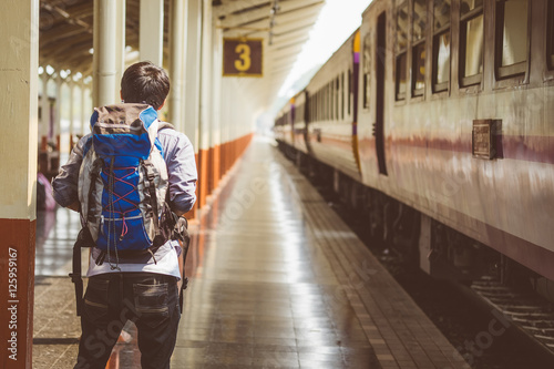 Fototapety, obrazy: Traveler with backpack in train station.