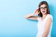 Leinwanddruck Bild - Portrait of a young beautiful confident woman in stylish glasses