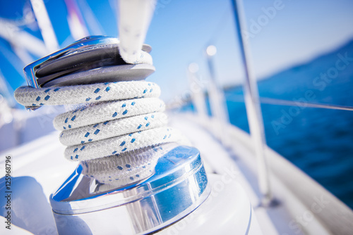 Sailboat winch and rope yacht detail. Yachting Fototapeta