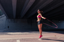 Fit Woman Runner Warming Up Outdoors