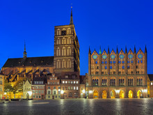 Stralsund, Germany. Night View Of Old Market Square With Nicholas' Church And City Hall In Brick Gothic Style.