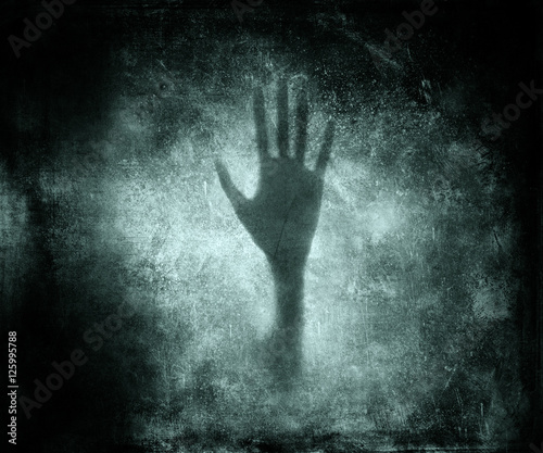 Photo  Silhouette of a hand. Scary Grunge Wallpaper.