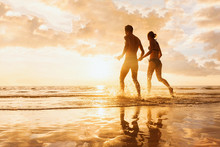 Happy Cheerful Couple Running ...