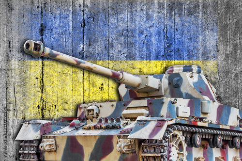 Military tank with concrete Ukraine flag