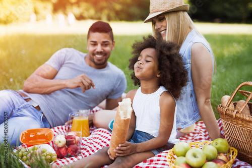 Happy family enjoying picnic Wallpaper Mural