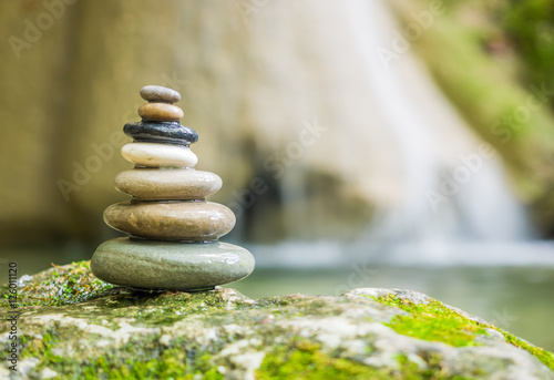 Foto auf Leinwand Zen Rock Zen Stack in front of waterfall.