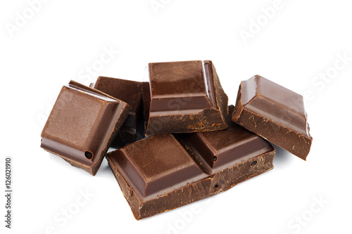 Foto op Aluminium Snoepjes Dark chocolate cubes isolated on white background.