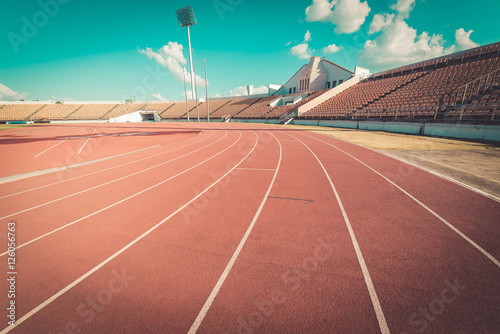 Fotografie, Obraz Red running track in stadium , vintage