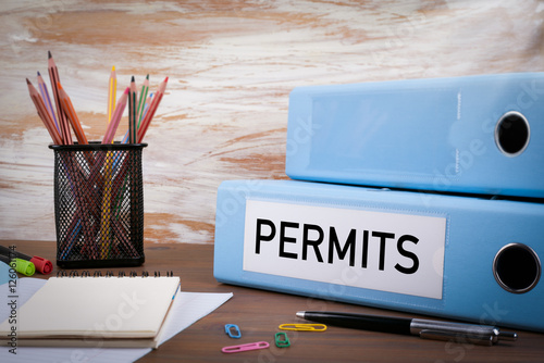 Fotografía  Permits, Office Binder on Wooden Desk. On the table colored penc