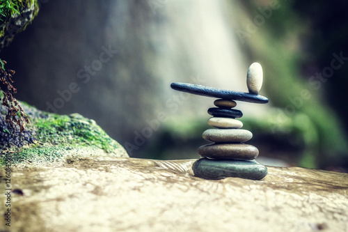 Rock Zen Stack in front of waterfall. Wallpaper Mural