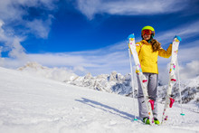 Smiling Girl Standing With Ski And  Arms Spreading Wide Open On