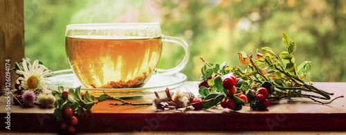 Cup of tea on the window sill. Hot tea. Tea leaves at the bottom of the cup. Delicious tea. Tea is waiting for ... It's tea time!