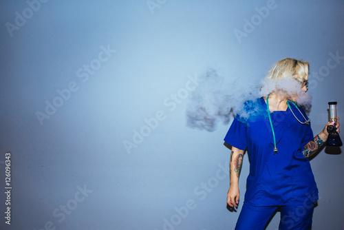 Young blonde nurse smoking pot Canvas Print