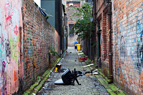 Canvas Prints Narrow alley Wheelie bins in a garbage strewn alleyway