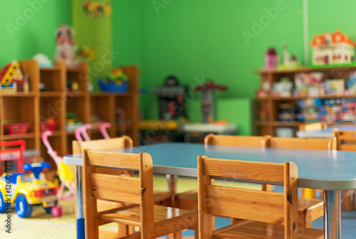 Valokuva  Chairs, table and toys. Interior of kindergarten.